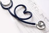 A blue stethoscope on a cardiogram — Stock Photo