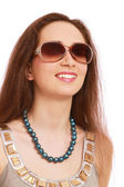 Portrait of a young girl wearing sunglasses — Stock Photo