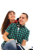 A young girl and a guy with headphones — Stock Photo