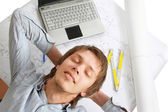 Pensive man at his workplace — Stock Photo