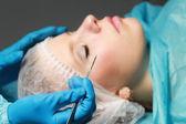 Woman receiving plastic operation — Stock Photo