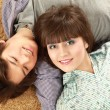 Young couple lying on floor — Stock Photo