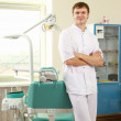 Man dentist at his office — Stock Photo #40378325