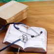 Stock Photo: Stethoscope with reference books