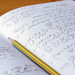 Stock Photo: Mathematics notebook with pencil