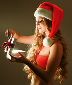 Smiling woman with gift — Stock Photo