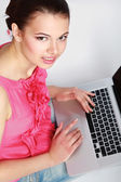 Portrait of beautiful woman with laptop — Stockfoto