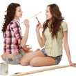 Young girls are painting and lying on the floor — Stock Photo