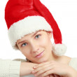 Portrait of a beautiful woman wearing a santa hat — Stock Photo #40382167