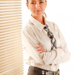 Young woman is standing in the office near window. — Stock Photo