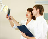 A medical doctors standing in dentist office. — Stock Photo