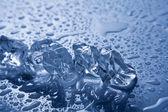 Melting ice on white background. — Stock Photo