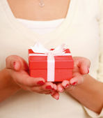 Close-up of woman with gift — Stock Photo