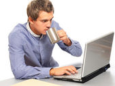 Handsome young man working with laptop. — Stock Photo