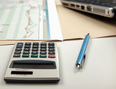 Office still-life, calculator and document. — Stock Photo