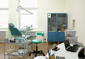Modern Dentist's chair in a medical room. — Foto Stock