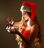 Woman wearing a santa hat — Stock Photo