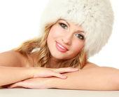 Beauty fashion model girl in a fur hat — Stock Photo