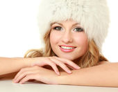 Beauty fashion model girl in a fur hat — Stock Photo