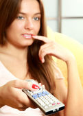 Woman   holding remote control panel TV — Stockfoto