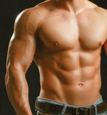 Healthy muscular young man — Stock Photo