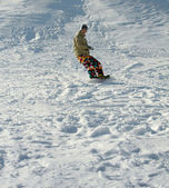 Snowboarder on slope — Foto Stock