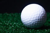 Golf ball ower green grass. — Stock Photo