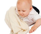 A baby covered with a towel — Stock Photo