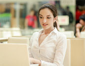 Woman sitting with laptop. — Stock Photo