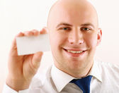 Handsome business with card — Stock Photo