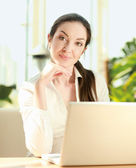 Woman sitting on the sofa with laptop. — Stock Photo