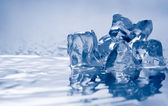 Melting ice on white. — Stock Photo