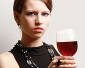 Woman with a wineglass — Stock Photo
