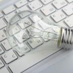 Light bulb and computer keyboard — Stock Photo #46523807