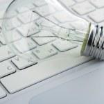 Light bulb and computer keyboard — Stock Photo #46524393