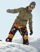 Snowboarder standing with board — Stock Photo