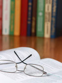Book with glasses on the desk — Stock Photo