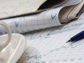 Calculator, pen, folder with documents, laptop — Stock Photo