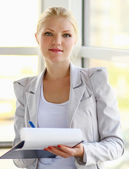 Portrait of the business woman with folder — Stock Photo