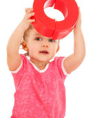 Portrait of a little girl in a helmet with blocks — Stock Photo