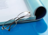 Glasses lying on a book — Stock Photo