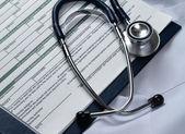 Doctor coat with stethoscope — Stock Photo