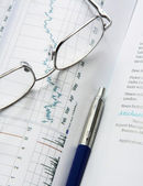 Eyeglasses   on a business document — Stock Photo