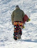 Snowboarder standing with snowboard — Stock Photo