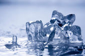 Melting ice on white — Stock Photo
