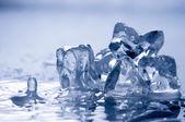 Melting ice on white — Stock Photo