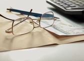 Calculator , folder with paper, pen and glasses — Stock Photo