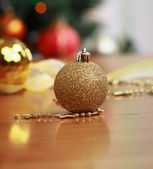 Ball on the background of Christmas tree — Stock Photo
