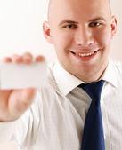 Business man holding blank — Stock Photo