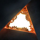 Triangle opening with gears made of rusty metal — Stock Photo